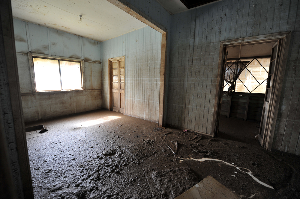 Thick mud covers the interior of a house from floor to ceiling in Goodna, Queensland.