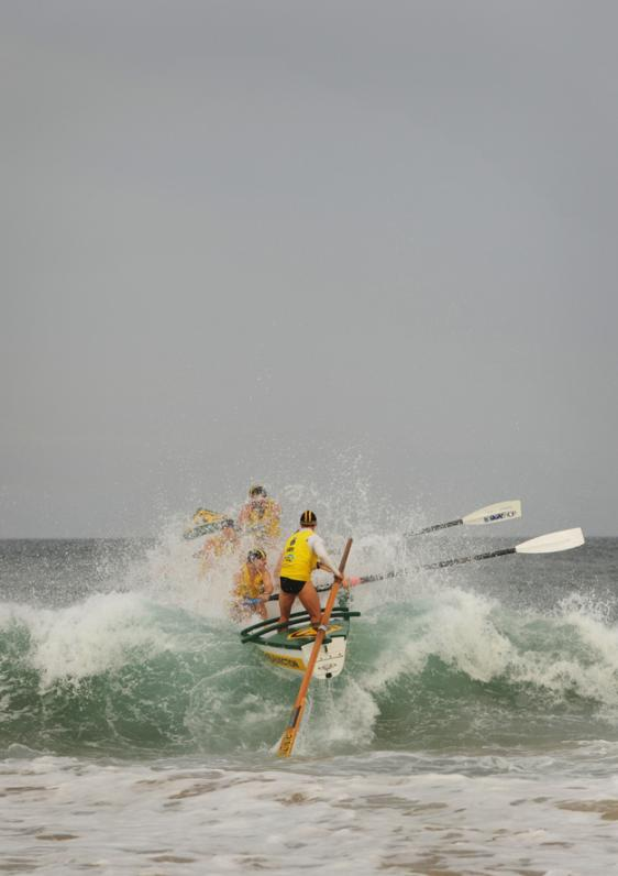 Reserves mens team Fairymeadow Finger Blasters compete in the Navy Surf Boat Challenge on Wollongong City Beach.