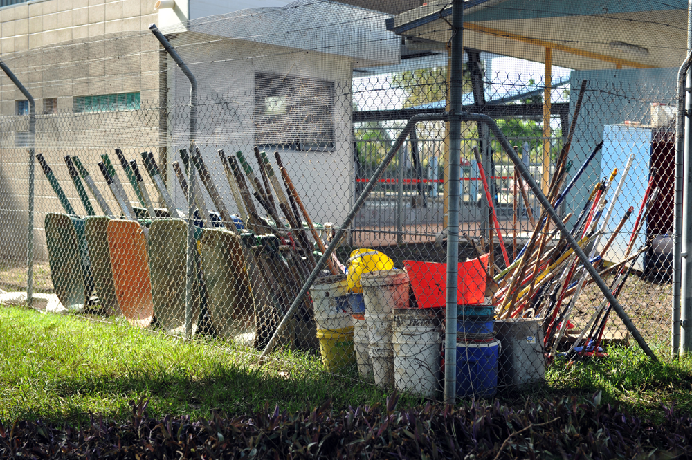 Cleaning tools are left to dry after cleaning the local swimming pool in Goodna, Queensland.