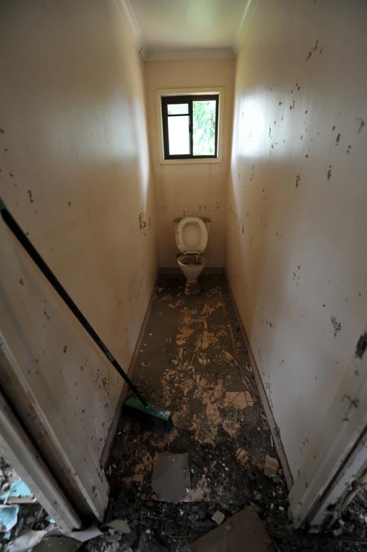 A toilet awaits it's turn to be stripped of gyprock in a house in North Booval, Queensland.