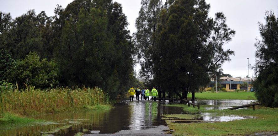 The body of a deceased man was found floating beside the Warilla Sports Club after being sucked under in the Oakleigh Creek during flash flooding across the Illawarra region.