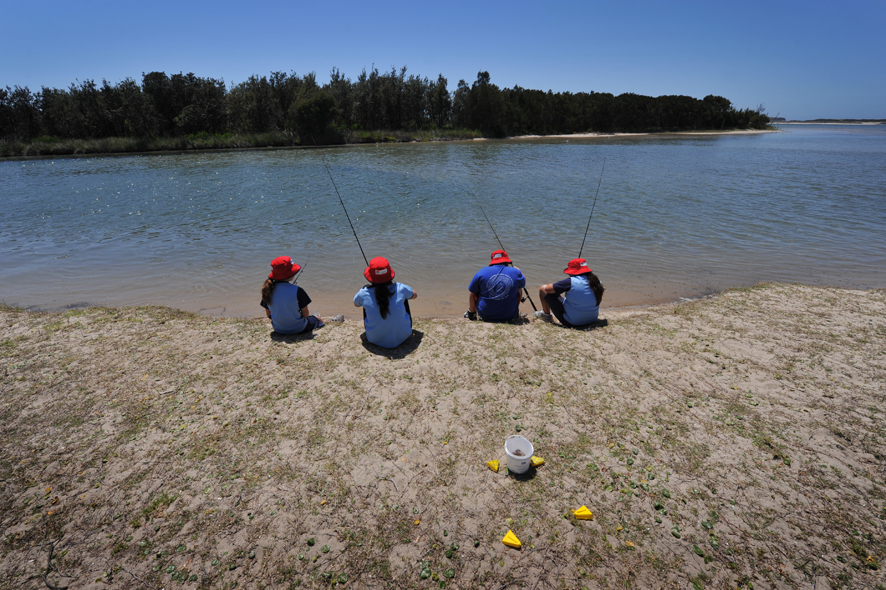 Children learn to fish in Lake Illawarra as part of their school curriculum.
